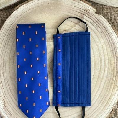 Corbata y mascarilla tnt azulina con la bandera de España La Casa Del Cofrade