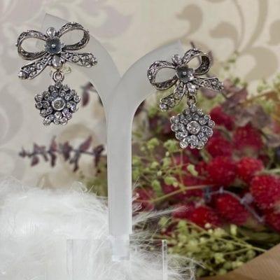 pendientes isabelinos con lazo en plata